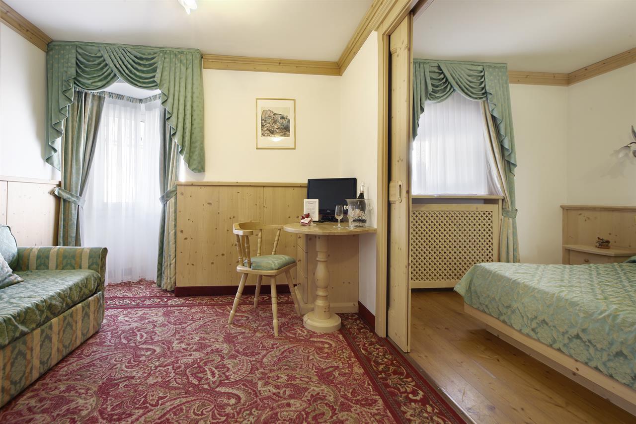 Hotel a Predazzo per famiglie - Hotel Touring, camera